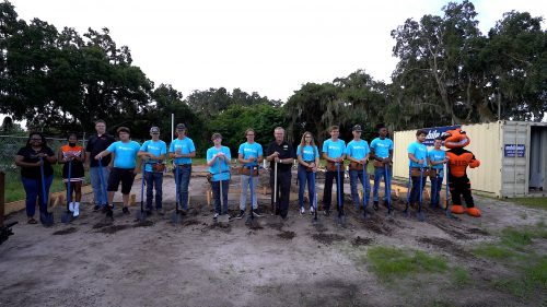 Students stand with shovels at the groundbreaking